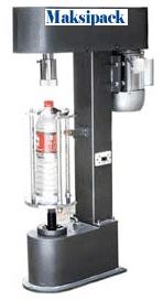 dk-50z-mesin-penutup-botol-plastik-maksipack-maksindo
